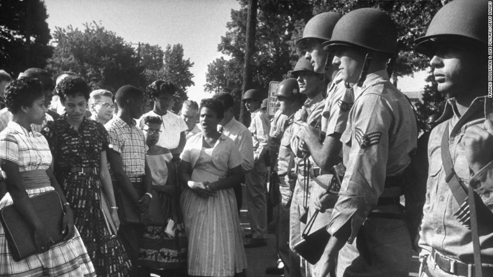 Arkansas National Guardsmen prevent African-American students from entering Little Rock Central High School.