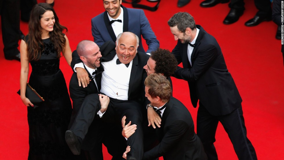 "Actor Gerard Jugnot is carried by members of the cast of ""Babysitting"" on May 16."