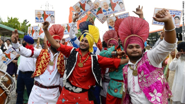 Indian artists dance as their country heads to the polls to vote in the 2014 elections.