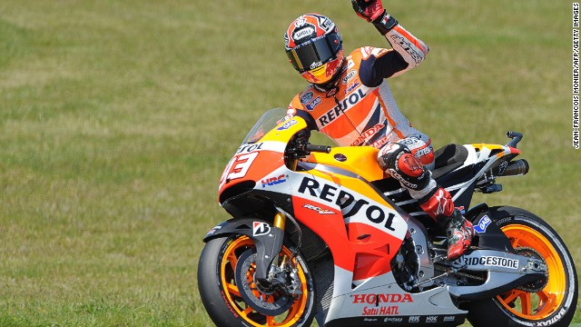 Spain's Marc Marquez acknowledges the crowd at Le Mans during qualifying for Sunday's French Grand Prix.