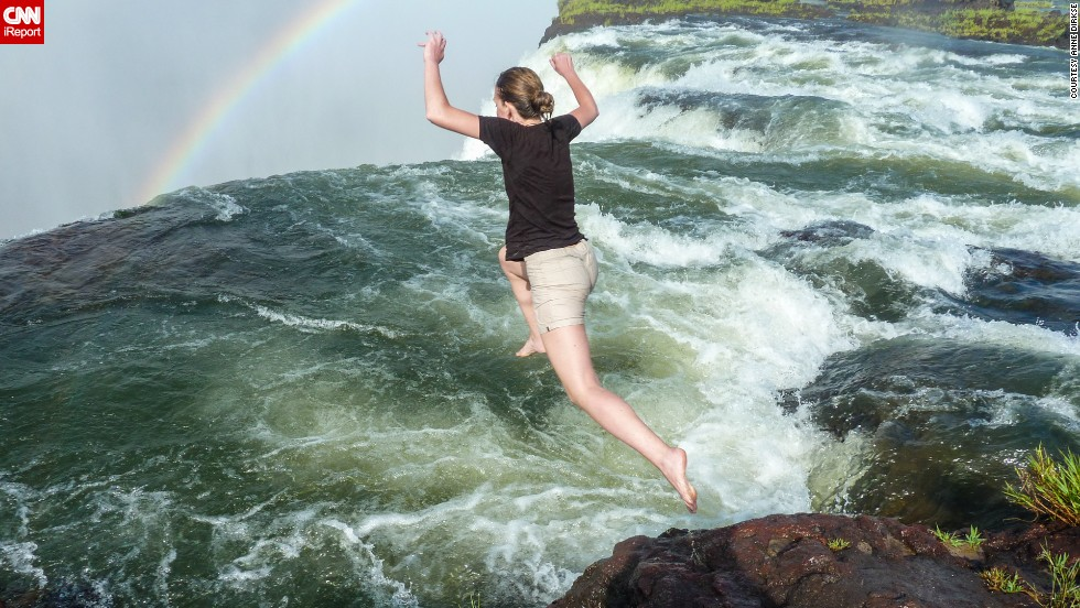 "If you're brave enough, you can jump into Devil's Pool, just above the falls on the Zambian side in <a href=""http://www.zimparks.org/index.php/parks-overview/national/national-parks"" target=""_blank"">Victoria Falls National Park</a>, as <a href=""http://ireport.cnn.com/docs/DOC-1129760"">Dirkse</a> did here. ""When the water is low, you can jump into the pool, where a natural rock wall stops you just at the edge of the falls,"" Dirkse said. ""It's an exhilarating experience."""
