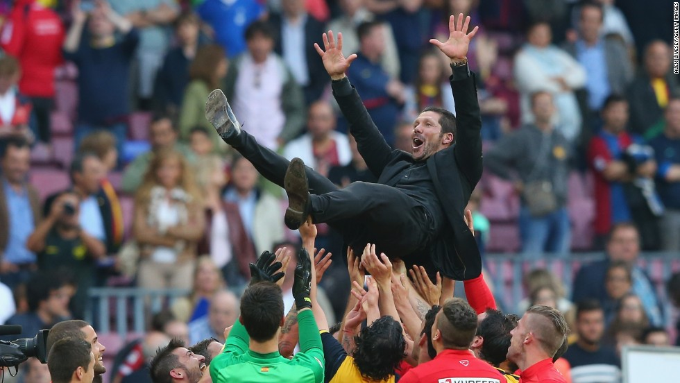 A jubilant Simeone was thrown in the air by his players following the 1-1 draw.