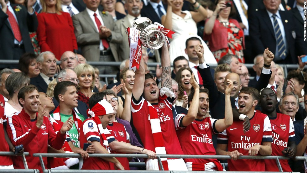 Arsenal players lift the FA Cup at Wembley Stadium following the fightback against Hull CIty on Saturday.