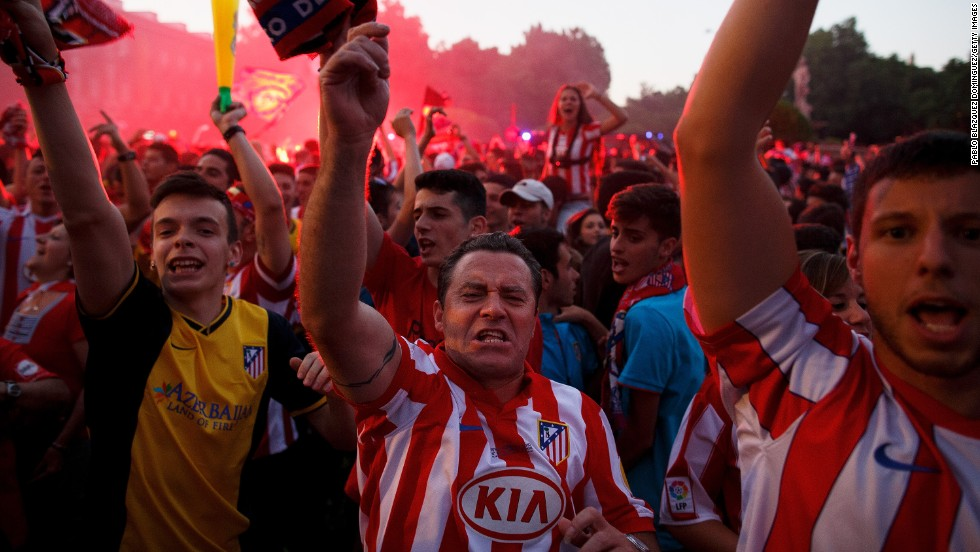 The worry and the waiting is over: Atletico fans celebrate in Madrid's Neptuno Square.