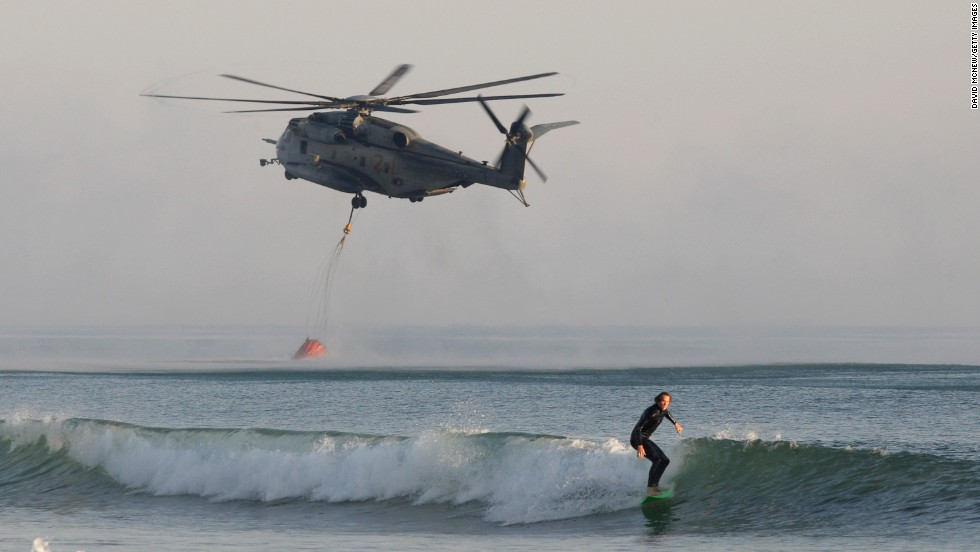 A Marine helicopter scoops water from the ocean to fight a wildfire near Camp Pendleton on May 16.