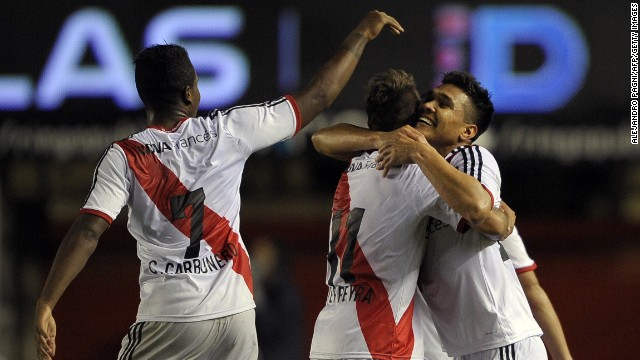 River Plate's forward Teofilo Gutierrez (R) celebrates with teammates after scoring the team's second goal against Argentinos Juniors during their Argentine First Division football match, at Diego Armando Maradona stadium in Buenos Aires, Argentina, on May 11, 2014. River won by 2-0. AFP PHOTO / Alejandro PAGNI (Photo credit should read ALEJANDRO PAGNI/AFP/Getty Images)