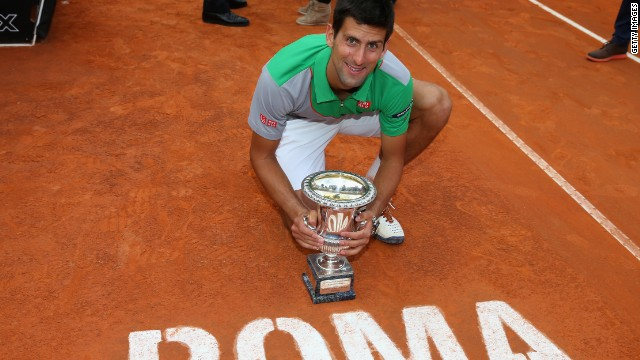 Novak Djokovic displays his Rome Masters trophy after coming back to beat Rafael Nadal.
