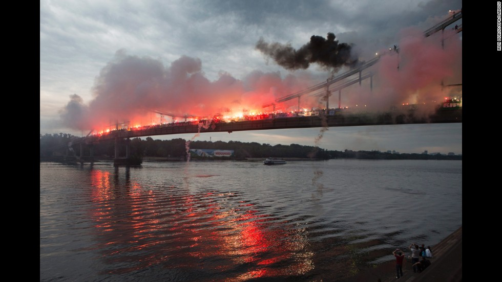 To show support for a united Ukraine, about 2,000 fans from six Ukrainian soccer clubs gathered Sunday, May 18, and burned flares on a bridge in the country's capital of Kiev.
