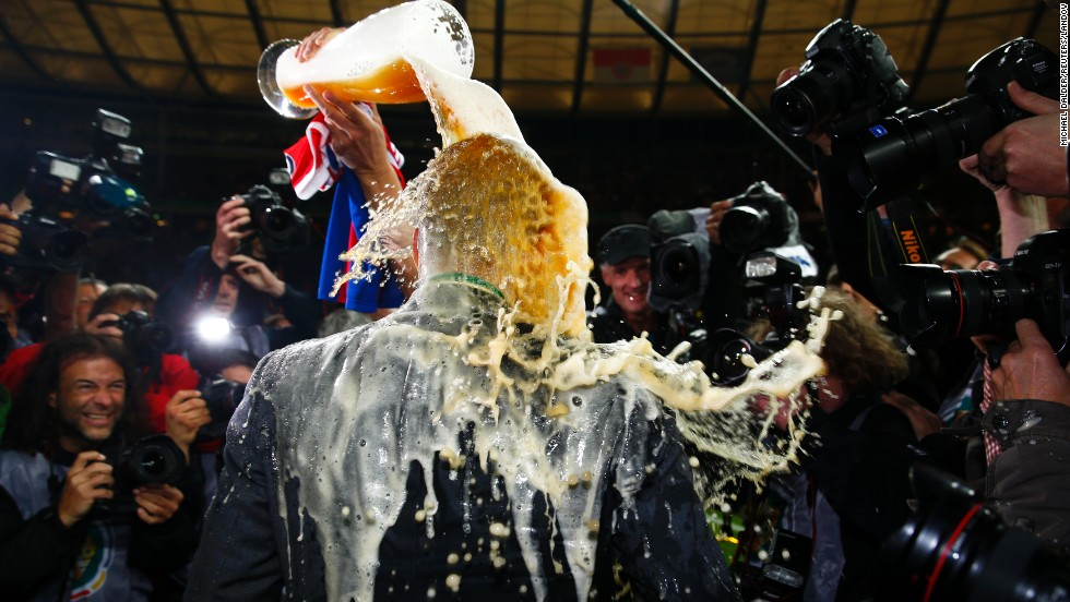 Bayern Munich manager Pep Guardiola is showered with beer after his team won the German Cup final Saturday, May 17, in Berlin. Bayern defeated Borussia Dortmund 2-0 to complete the domestic double this season. They also won the German league title.