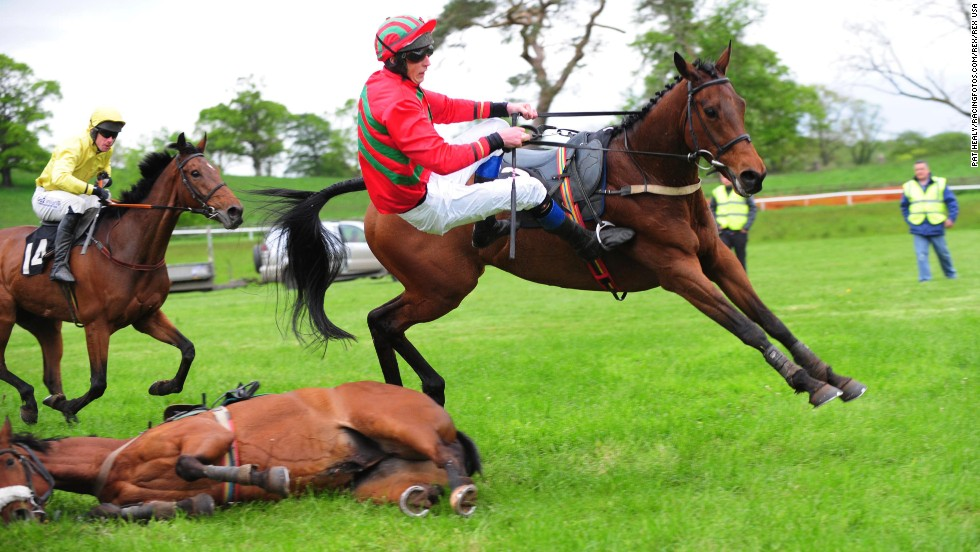 Mark Foley falls off his horse Saturday, May 17, at a race in Irvinestown, Northern Ireland. There were no injuries.