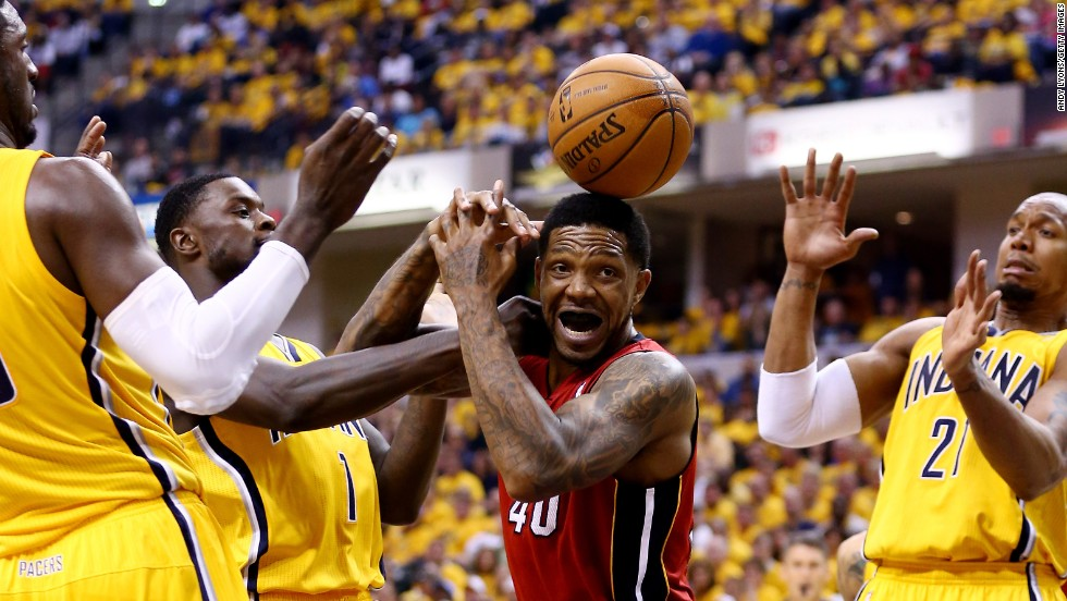 The Miami Heat's Udonis Haslem, center, loses control of the ball during Game 1 of the NBA's Eastern Conference finals Sunday, May 18, in Indianapolis. The Indiana Pacers won the series-opening game 107-96.