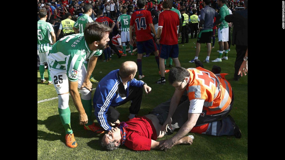 An injured fan receives medical assistance after a railing collapsed Sunday, May 18, during a Spanish league soccer match between Osasuna and Real Betis in Pamplona, Spain. Several fans were injured in the collapse, which happened after Osasuna's opening goal in the 12th minute of play. The match resumed after 35 minutes, and Osasuna won 2-1.