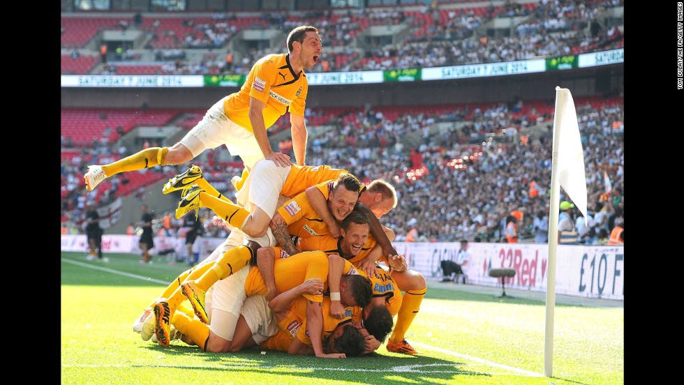 Cambridge United players celebrate a goal by Ryan Donaldson during the Conference Premier playoff final Sunday, May 18, in London. The team's 2-1 win over Gateshead secured its promotion into England's Football League.