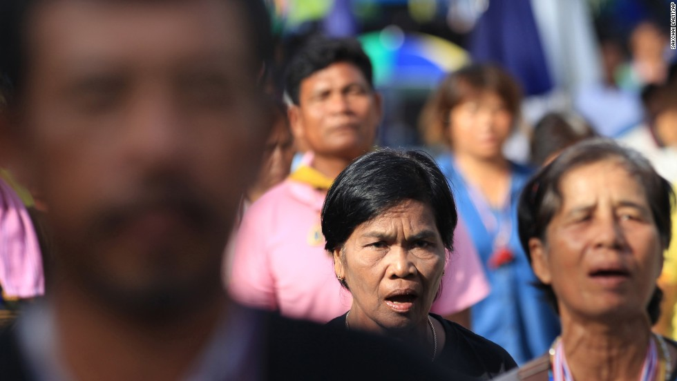 Anti-government protesters listen to their national anthem during a gathering in Bangkok on May 20.