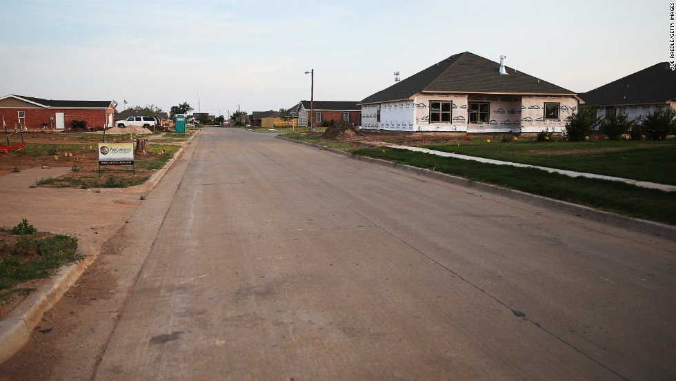 <strong>Now:</strong> Construction continues along the residential street on May 18, 2014.