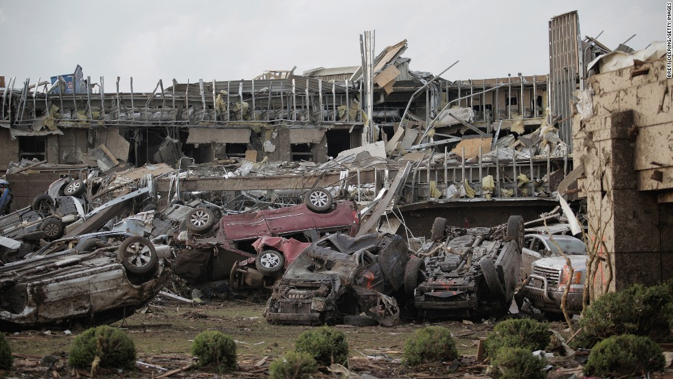 <strong>Then:</strong> Flipped vehicles pile up outside the Moore Medical Center on May 20, 2013.