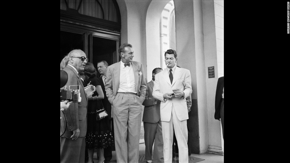 Cigarettes and bow ties were the height of fashion in the 50s. U.S. actor Gary Cooper (bow tie) talks to French actor Jean Marais (cigarette) during the Cannes Film Festival in 1953.
