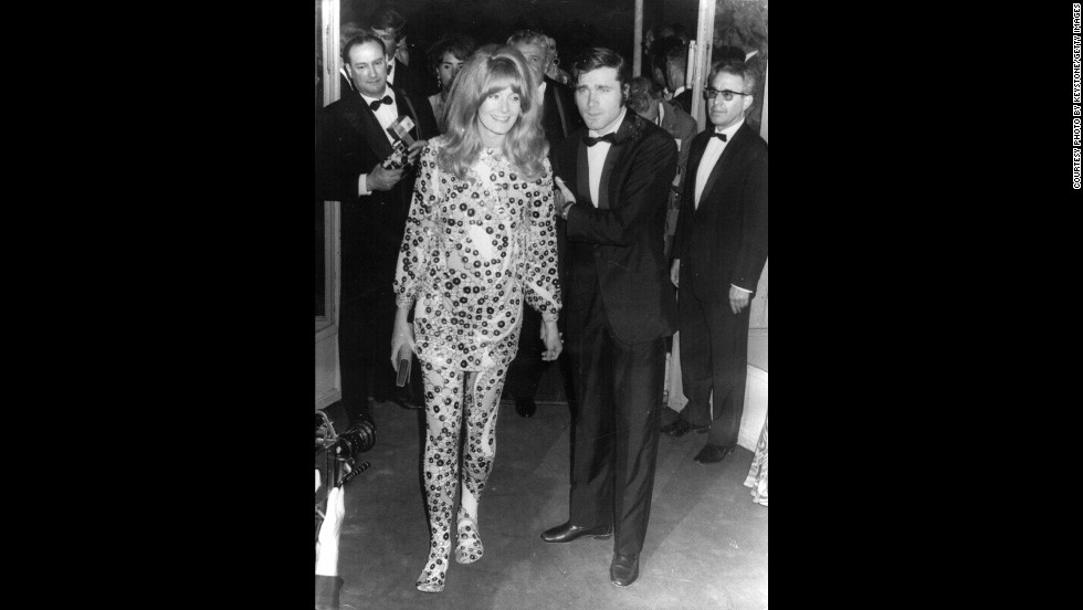 "Vanessa Redgrave sports an intricate two piece as she's photographed with Italian actor Franco Nero at the premiere of her film ""Blow Up"" in 1967. The film is about a fashion photographer who believes he may have witnessed a murder and unwittingly taken photographs of the killing."