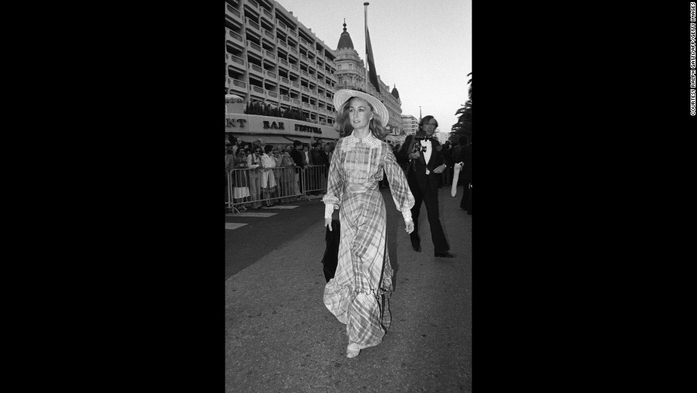 "French actress Brigitte Fossey arrives at the 1977 film festival in long checked dress with lace detailing and a provincial straw hat. Fossey was just five years old when she was cast by director René Clément to star in his film, ""Forbidden Games."""