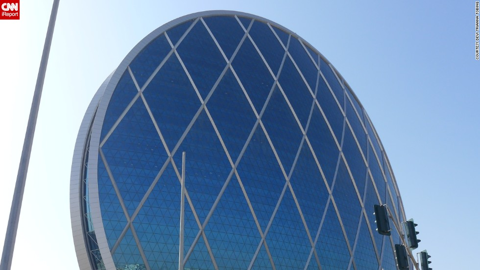 "Completed in 2010 in Al Raha Beach, United Arab Emirates, the <a href=""http://www.aldar.com/en/project/projects/hq-1"" target=""_blank"">Aldar Headquarters building</a> resembles a glass-covered wheel. The 23-story office space follows LEED standards for environmentally exceptional buildings. It has has become a city landmark, says <a href=""http://ireport.cnn.com/docs/DOC-1123294"">Devi Trianna</a>, who predicts the cities of the future will be more environmentally friendly."