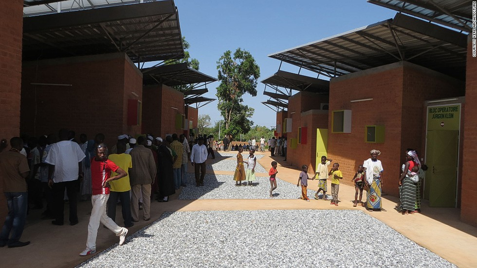 "Opened in June 2014, the Surgical Clinic and Health Center in Léo serves a population of over 50,000 people. For the construction, characteristic mud bricks were used with a 'flying roof'. The high thermal mass of the bricks ""allow them to absorb cool night air and releasing it during the day."""