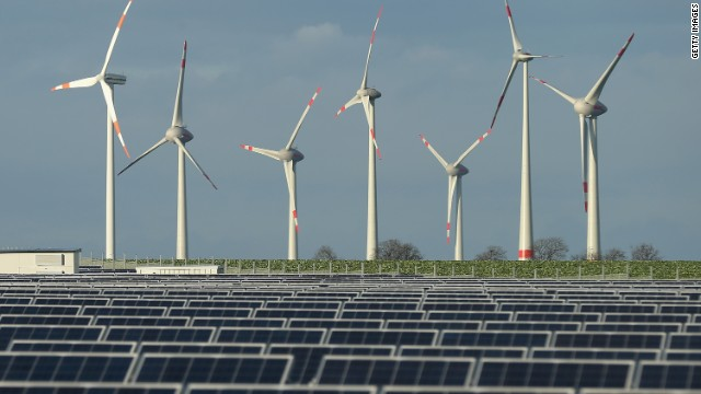 Wind turbines stand behind a solar power park on October 30, 2013 near Werder, Germany.