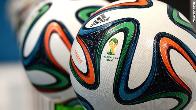 "The Adidas official FIFA World Cup ball ""Brazuca"" are present beside of former World Cup ball's during the company's shareholders' meeting in Fuerth, southern Germany, on May 8, 2014. Adidas, the German maker of sportswear and equipment, said that earnings were down in the first quarter, hit by unfavourable exchange rates and the strong euro. AFP PHOTO/CHRISTOF STACHECHRISTOF STACHE/AFP/Getty Images"