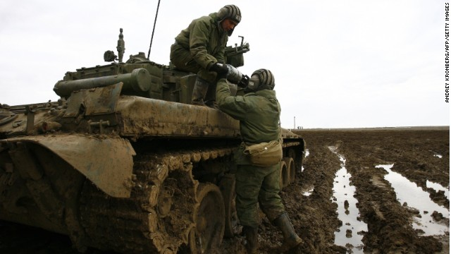 Russian soldiers load rounds into their tank during military exercises in the southern Russia's Volgograd region, on April 2, 2014.