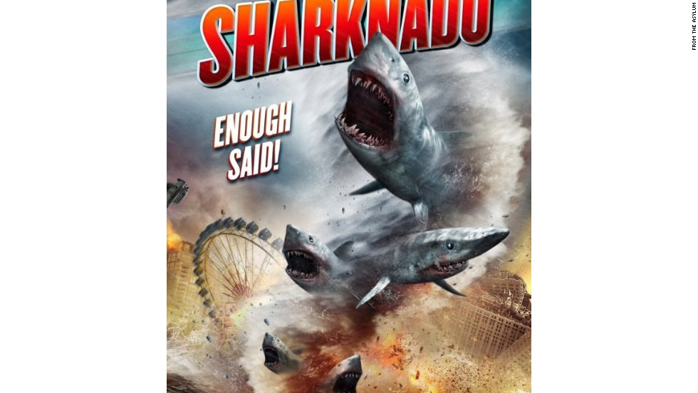 "What selection of b-movie film posters would be complete without the crossover hit, ""Sharknado?"" For those of you who somehow missed it, when a freak hurricane swamps Los Angeles, nature's deadliest killer rules sea, land, and air as thousands of sharks terrorize the waterlogged populace."