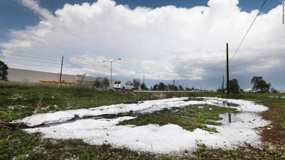 A cloud drifts away after the storm left fresh hail on the ground in the Denver metro area on May 21.