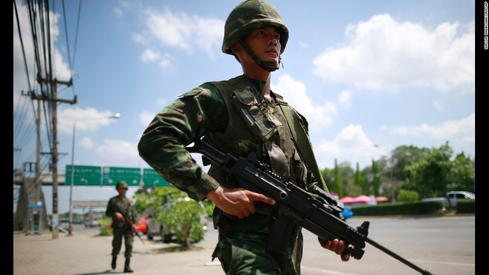 Thai soldiers patrol near a rally site for pro-government demonstrators on the outskirts of Bangkok on Thursday, May 22.