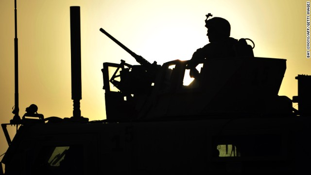 A  U.S. Marine stands guard in Afghanistan's Helmand Province in on May 9, 2011.