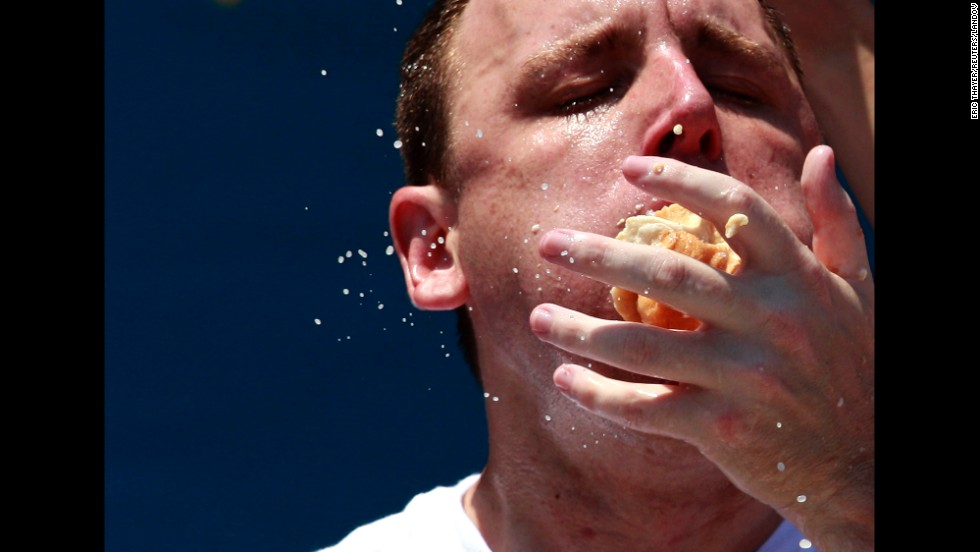 Competitive eater Joey Chestnut competes in the 2012 Nathan's July Fourth hot dog eating contest at New York's Coney Island. Chestnut ate a record-tying 68 hot dogs to win.