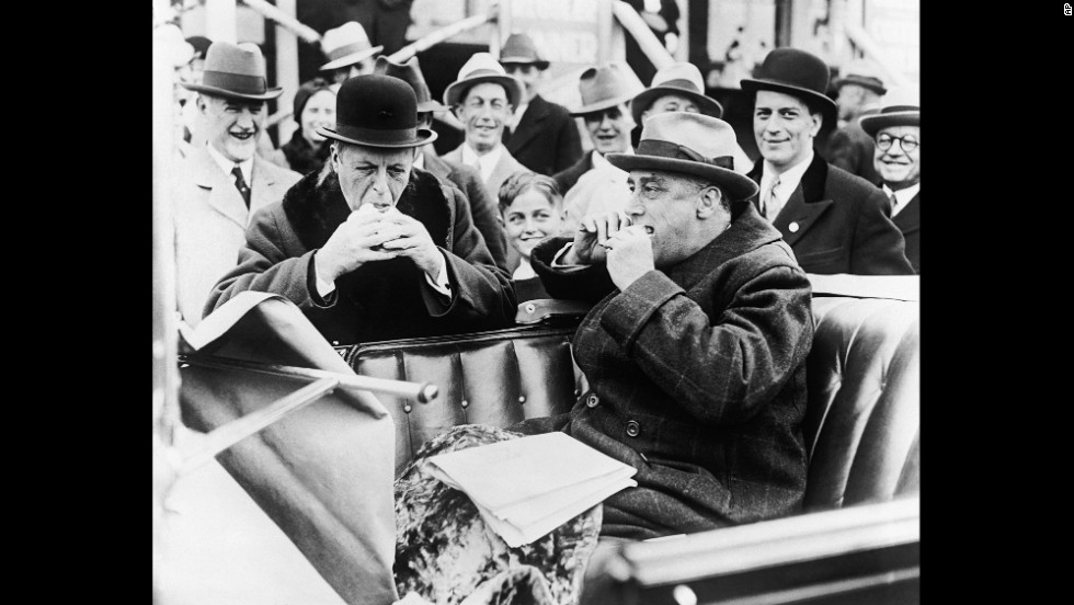 Massachusetts Gov. Joseph Ely, left, and New York Gov. Franklin D. Roosevelt stop for a hot dog on the Mohawk Trail in Massachusetts, where the two campaigned together in 1932.