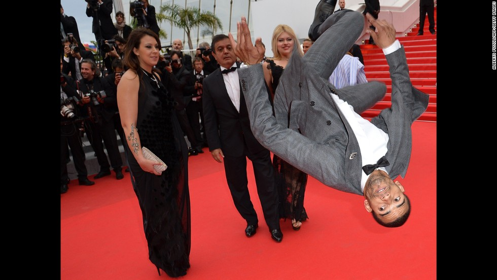 "French dancer Brahim Zaibat leaps on the red carpet Monday, May 19, as he attends the premiere of the movie ""Foxcatcher"" at the Cannes Film Festival. This is the 67th year of the international film festival, which runs until Sunday, May 25, in southern France. <a href=""http://www.cnn.com/2014/05/14/showbiz/gallery/cannes-red-carpet/index.html"">See more shots from the red carpet</a>"