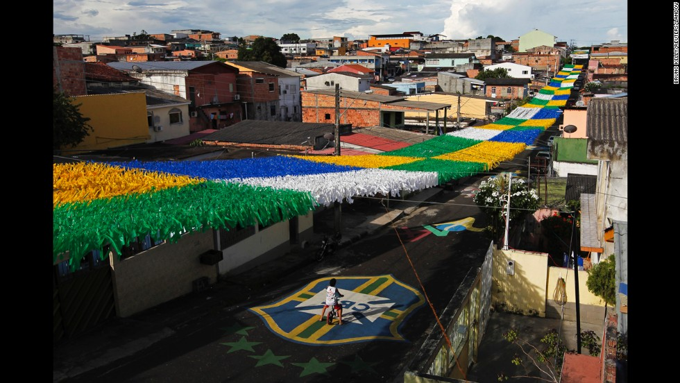 A boy rides his bicycle along a street in Manaus, Brazil, on Saturday, May 17. The street is decorated for the upcoming World Cup soccer tournament, which will be held in 12 Brazilian cities, including Manaus, starting next month.