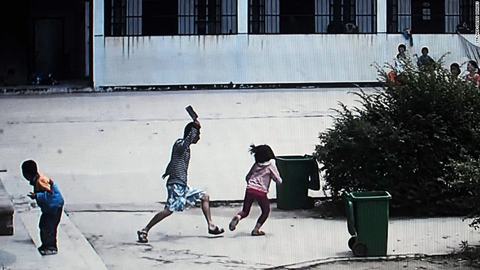 "This picture, taken from security camera video, shows a knife-wielding attacker going on a rampage at a primary school in Macheng, China, on Tuesday, May 20. Eight students were injured in the attack, according to the <a href=""http://www.scmp.com/news/china/article/1516758/children-attacked-knifeman-hubei-school"" target=""_blank"">South China Morning Post</a>."