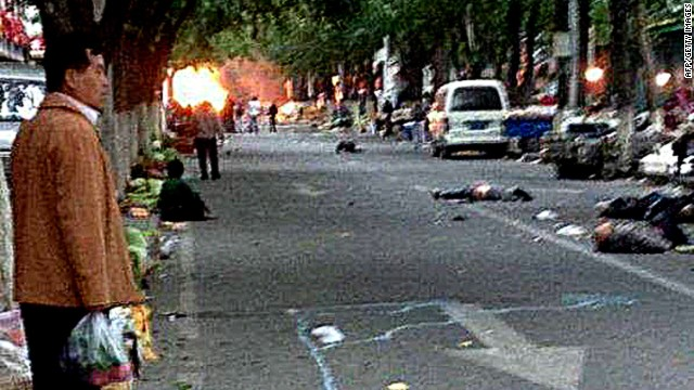 "Victims of a bombing lie on a street near the site where attackers ploughed two vehicles into a market and threw explosives, killing at least 31 people, in Urumqi in northwest China's Xinjiang region on May 22, 2014. More than 90 people were also wounded when two off-road vehicles drove into a crowd in Urumqi, with one of them exploding, the regional government's Tianshan web portal said, in what authorities called the latest ""severe terrorist incident"" to hit the Muslim Uighur homeland. CHINA OUT AFP PHOTO/STRSTR/AFP/Getty Images"