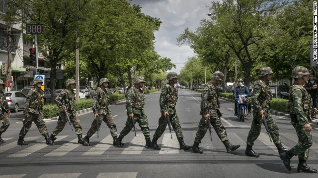 BANGKOK, THAILAND - MAY 23:  Thai soldiers patrol near government  buildings on May 23, 2014 in Bangkok, Thailand. The Army chief announced in an address to the nation that the armed forces were seizing power in a non-violent coup. Thailand has seen months of political unrest and violence which has claimed at least 28 lives. (Photo by Paula Bronstein/Getty Images)