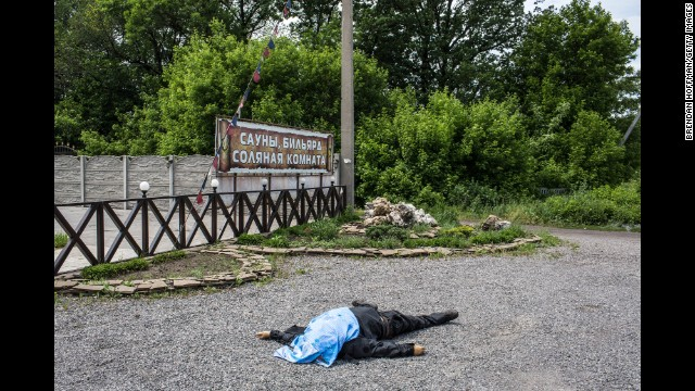 The body of a pro-Ukraine militia fighter lies along a road in Karlivka on May 23.