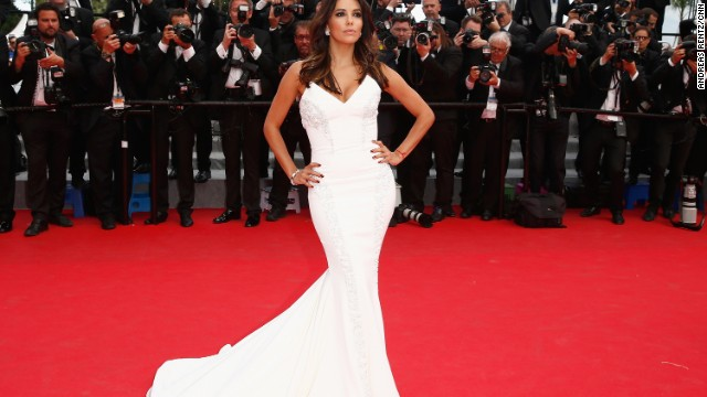 "Eva Longoria stuns on the red carpet at the premiere of ""Saint Laurent"" at Cannes 2014."