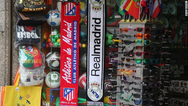 Real Madrid and Atletico de Madrid scarves are seen hanging outside a shop ahead of the UEFA Champions League Final on May 23, 2014 in Lisbon, Portugal