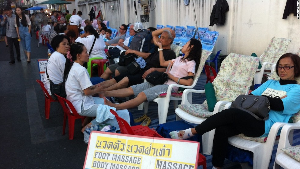 At Chiang Mai's weekend market, entrepreneurial massage ladies lure shoppers with $5-an-hour foot rubs.