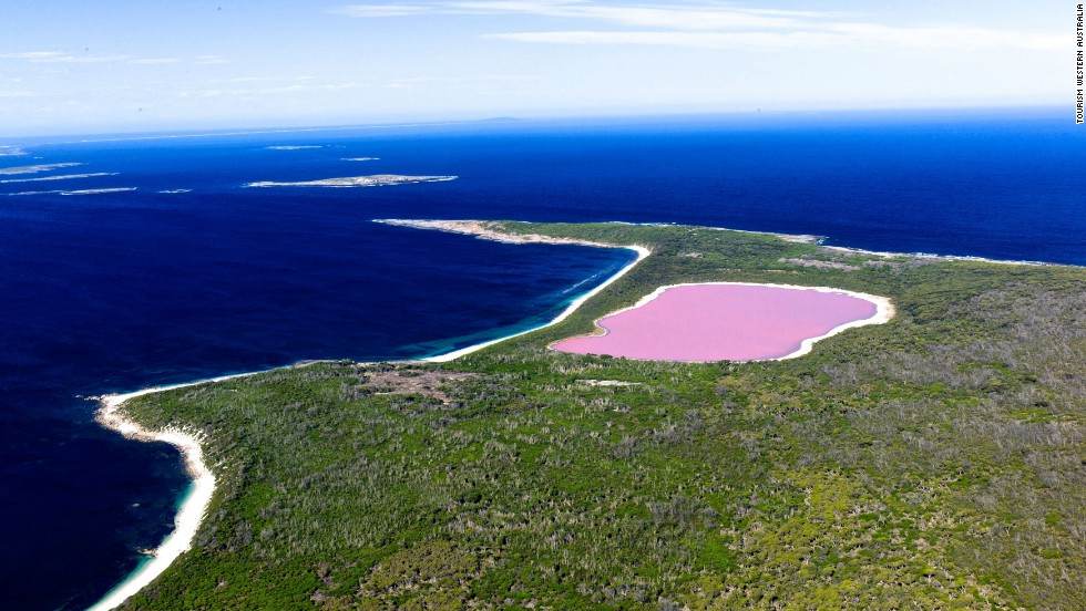 Bubblegum-pink Lake Hillier is a nearly 2,000-foot-wide lake on Middle Island, the largest of the Recherche island chain in the state of Western Australia. The remote lake is accessible via plane or boat excursion from nearby Esperance. The cause of the Lake Hillier's color isn't fully known. A high level of salinity and dye-producing bacteria are possible sources of the distinctive hue.