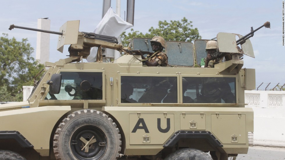 African Union troops arrive in an armored vehicle.