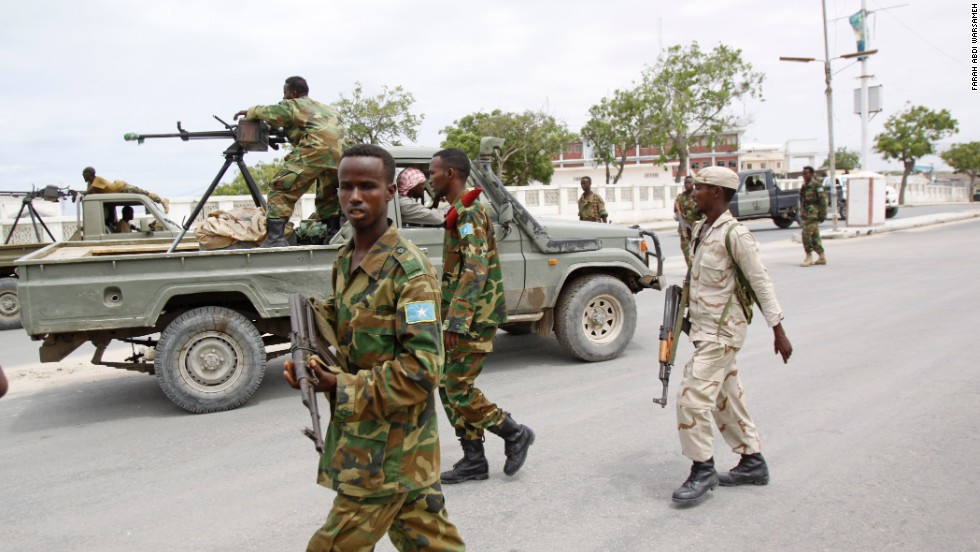 Somali government soldiers patrol the area during the attack.