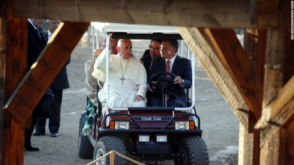 Pope Francis rides in a golf cart with King Abdullah II of Jordan on May 24 as they visit Bethany, on the eastern bank of the Jordan River.