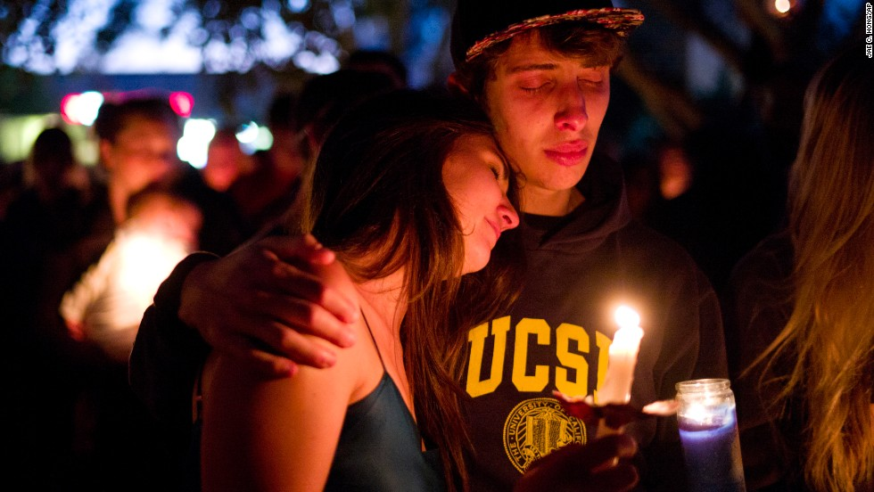 Two students comfort each other during the candlelight vigil to honor the victims of Friday night's mass shooting in Isla Vista.