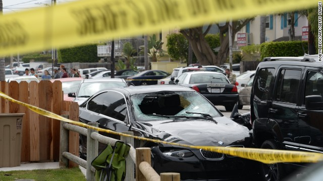 Caption:A crashed car, allegedly driven by a gunman, sits partly on the sidewalk on May 24, 2014 in Isla Vista, California, a beach community next to the University of California Santa Barbara. Seven people, including the gunman, were killed and seven others wounded in the May 23 mass shooting, Santa Barbara County Sheriff Bill Brown said Saturday. Brown said at a pre-dawn press conference that the shooting in the town of Isla Vista 'appears to be a mass murder situation.' Driving a black BMW, the suspect opened fire on pedestrians from his vehicle at several locations in the town. Police received their first emergency calls about the shooting around 9:30 pm Friday (0430 GMT Saturday). AFP PHOTO/ROBYN BECK (Photo credit should read ROBYN BECK/AFP/Getty Images)