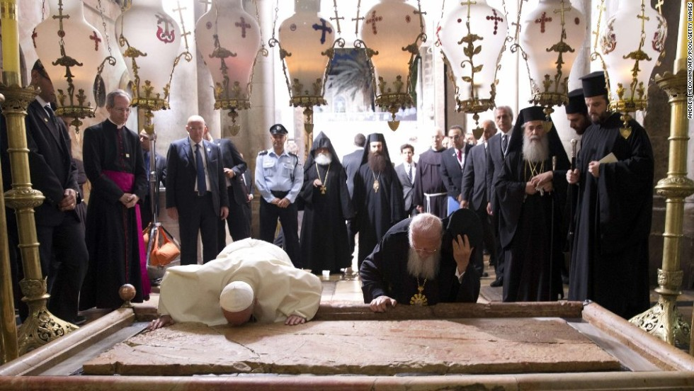 Francis and Ecumenical Patriarch of Constantinople Bartholomew I pray over the Stone of Unction at the Church of the Holy Sepulchre in Jerusalem's Old City on Sunday, May 25. The Pope joined Bartholomew in a historic joint prayer for Christian unity at Christianity's holiest site in Jerusalem.